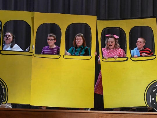 "(L-R) Snoopy, played by Briana Lander, Schroeder, played by Isaac Scales, Peppermint Paddy, played by Cecilia Susott, Sally, played by Faith Taylor, Linus, played by Noah Schaefer and Lucy, played by Alex Wagner on the school bus during a rehearsal of the Tecumseh High School spring musical ""You're a Good Man, Charlie Brown"" Wednesday, April 12, 2017."