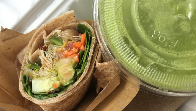 A vegetable wrap and Sun God Elixir smoothie from Green Cup Cafe in downtown Fort Myers.