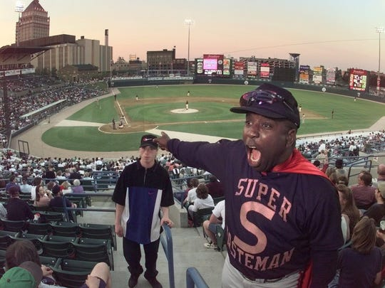 """Ogden Whitehead, better known as """"Waste Man"""" around Frontier Field, tries to get the crowd into a cheer during the Red Wings game."""