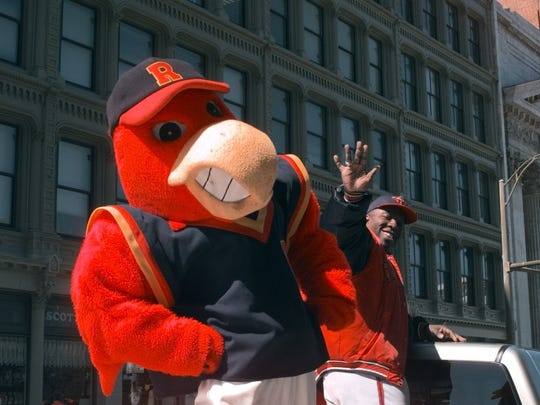 Red Wing's Mascot Spike and Waste Man, Ogden Whitehead, wave to the crowd during the Welcome Home Red Wings Parade, held at lunch time, downtown on April 7, 1999.