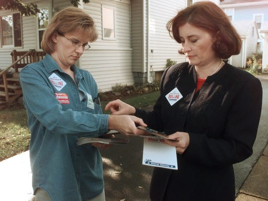Republican candidate for District Attorney Elma Bellini, right, gets a fresh pile of campaign literature from her campaign coordinator Dawn Nettnin as they knock on doors along Elm St in East Rochester, Saturday, Oct 9, 1999. For Rosenberg story. (Democrat & Chronicle, Photo by Annette Lein, 100999)