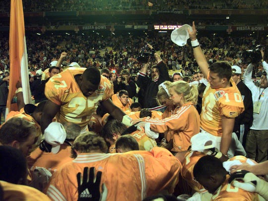 Tennessee's Al Wilson leads in prayer after the Vols won the National Championship Jan. 4, 1999, at the Fiesta Bowl in Tempe, Ariz.