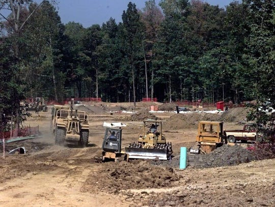 Earth moving equipment grades the area where the Garfield's