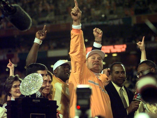 Tennessee coach Phil Fulmer celebrates winning the