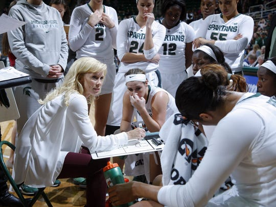 Michigan State coach Suzy Merchant, left, talks to her team during a game earlier this season. Merchant returned to the team missed for Saturday's game against Nebraska. She missed Wednesday's game at Purdue after fainting during last weekend's win over Illinois.