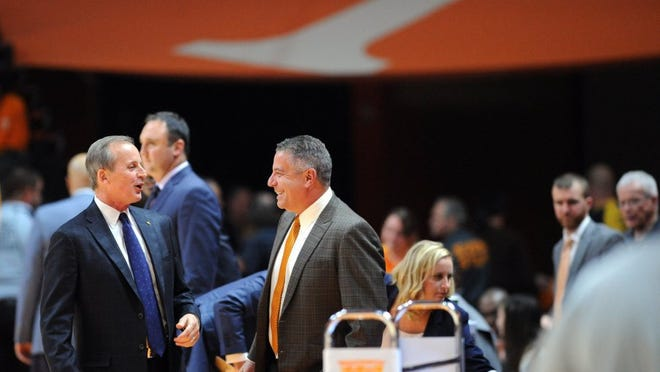Tennessee head coach Rick Barnes and Auburn head coach Bruce Pearl, from left, chat courtside before the first half at Thompson-Boling Arena on Tuesday, Feb. 9, 2016. (ADAM LAU/NEWS SENTINEL)