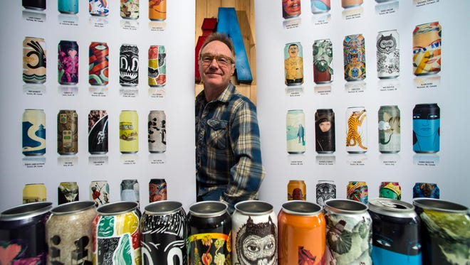 Bob Russell of Collective Arts Brewing with an assortment of the brewery's cans in Stowe Monday, November 28, 2016.  The brewery, which solicits work from artists to cover their cans, is beginning to sell its beer in Vermont.