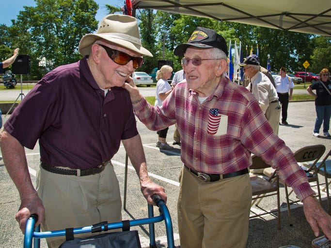High school classmates and WWII veterans Harry Shaffer Jr., left, and Jimmy Shafer see each other for the first time in 10 years during a ceremony honoring WWII veterans on the 70th anniversary of D-Day Friday, June 6, 2014, at VFW Post 9383 in Delphi.