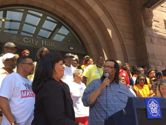 City Councilman Adam McFadden leads the Father's Day Pledge at City Hall.