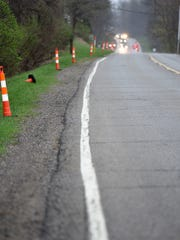 Traffic cones are placed along M-59 as road work began
