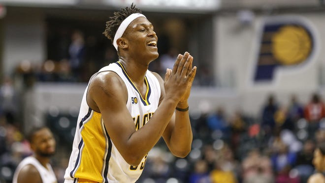 Indiana Pacers center Myles Turner (33) pleads to not be called for the technical foul after hanging on the rim after a dunk against the Brooklyn Nets in the second half at Bankers Life Fieldhouse on Thursday, Jan. 5, 2017.