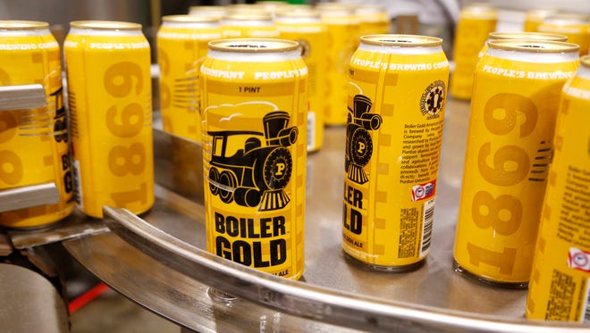 Boiler Gold American Ale rolls off the canning lineThursday, August 31, 2017, at People's Brewing Company, 2006 N. 9th Street in Lafayette.
