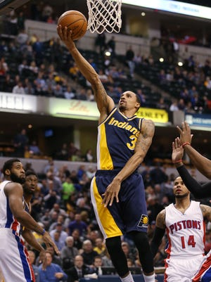 Indiana Pacers guard George Hill drives the lane for two points in the first quarter. The Pacers hosted the Pistons at Bankers Life Fieldhouse Wednesday, February 4, 2015.