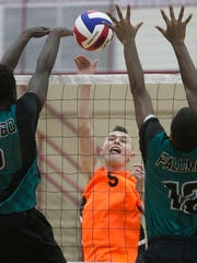 York Suburban's Kaleb Ansell goes up for a spike against
