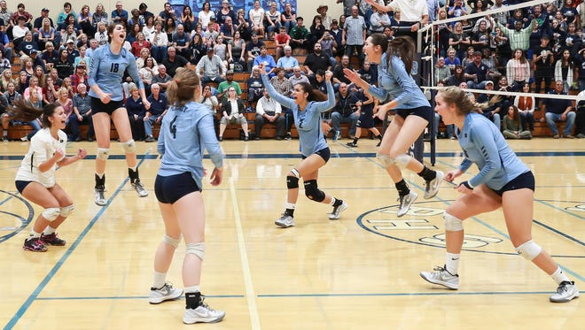 The Redwood Rangers celebrate their victory against the Central Valley Christian Cavaliers in a Central Section Division II quarterfinal girls volleyball match.