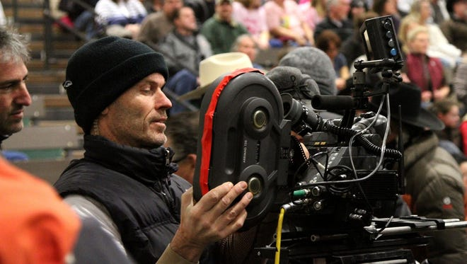 A camera man films a Dodge truck commercial at the Montana Pro-Rodeo Circuit Finals in the Four Seasons Arena in Great Falls in 2012.