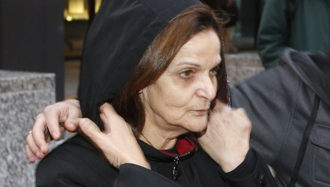 Rasmieh Yousef Odeh departs the federal courthouse after her initial appearance before U.S. Magistrate Judge Michael Mason on Oct. 22, 2013, in Chicago.