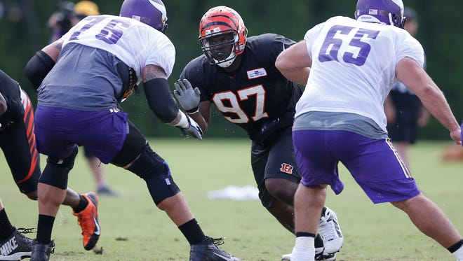 Bengals defensive tackle Geno Atkins (center) works the offensive line during a joint practice with the Minnesota Vikings on Aug. 11.