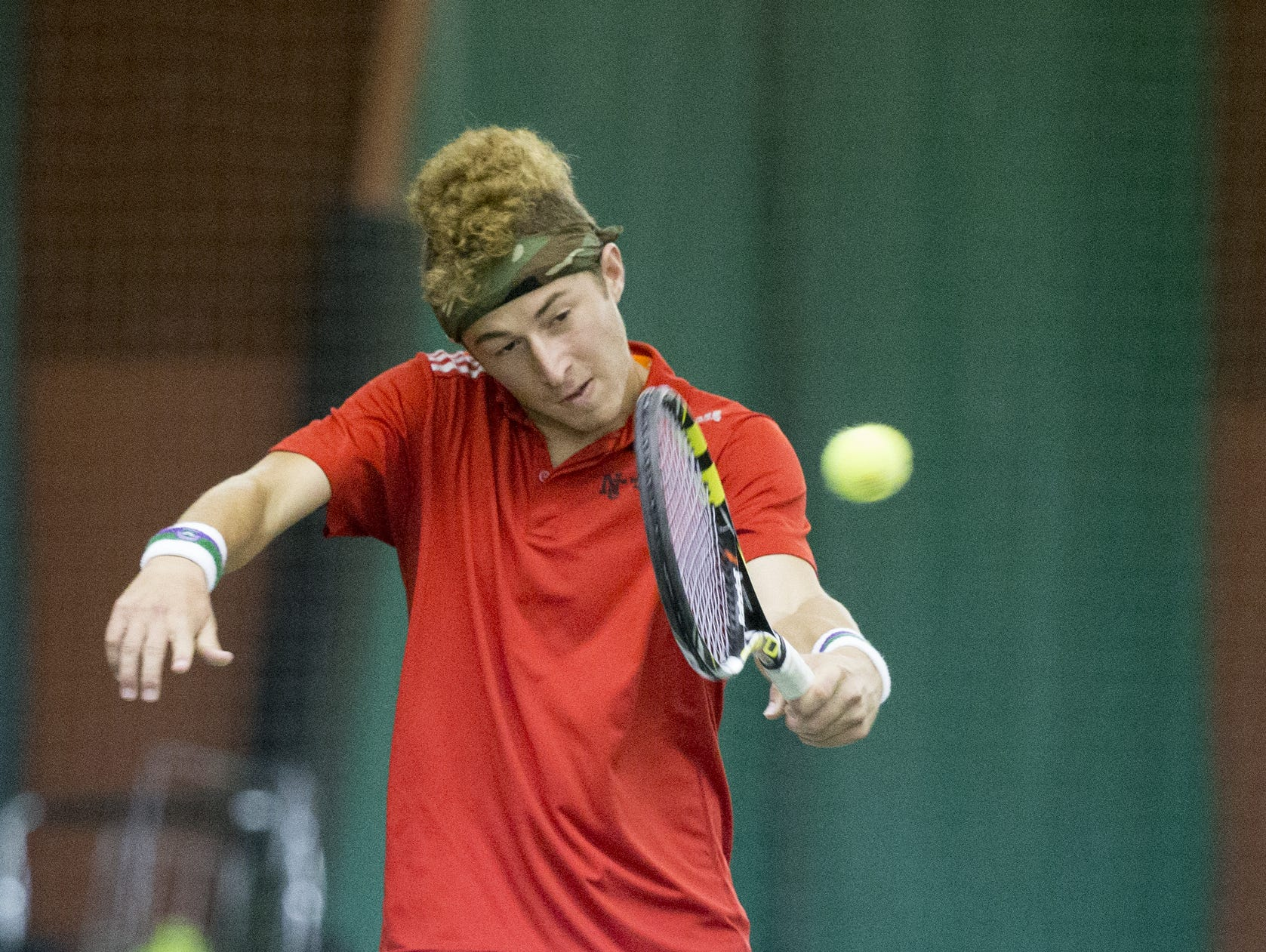 Jonathan Kroot of North Central High School, returns a shot during the third seed singles match, IHSAA Boys Team Tennis State Finals, Indianapolis, Saturday, October 18, 2014.