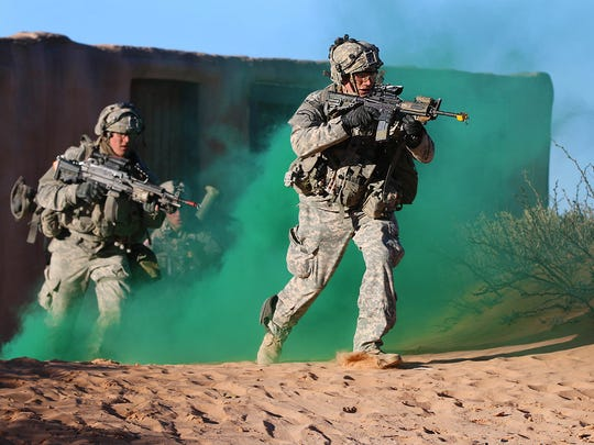 Soldiers from 3rd Battalion, 7th Infantry Regiment, 2nd Infantry Brigade Combat Team, 3rd Infantry Division from Fort Stewart, Ga., engage enemy targets while maneuvering forward on El Jarbah, a mock urban village, at McGregor Range on Feb. 3 during Iron Focus 16.2. Iron Focus is the 1st Armored Division's premier training event to prepare subordinate units for worldwide operations and combat training center rotations.