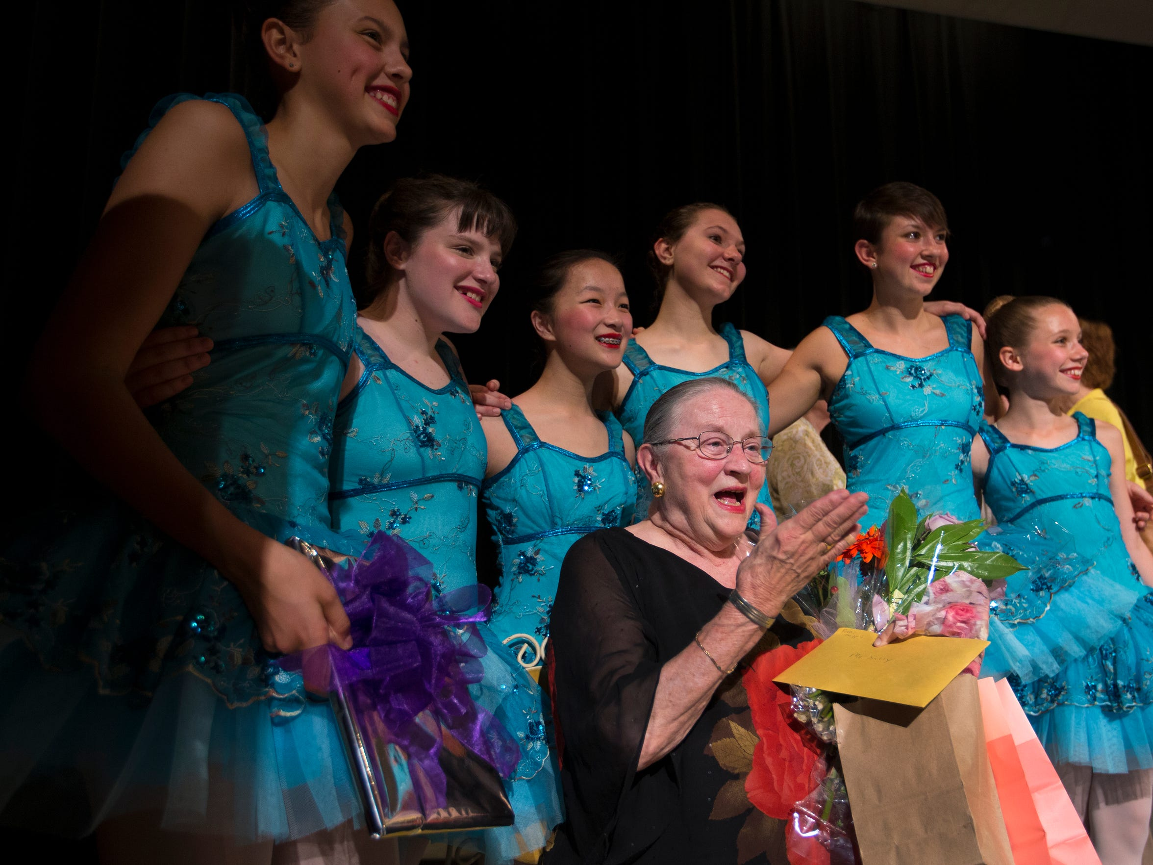 Sally Rothenburger blew a kiss to the audience while being surrounded by a group of her dancers following the last recital for her Ballet Arts Studio. Rothenburger is closing the business after 47 years due to the closing of the Clifton Center. May 21, 2017.