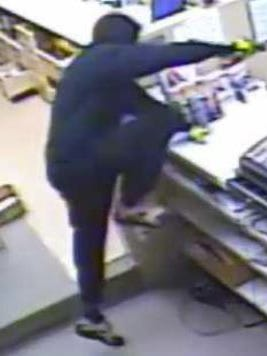 A suspect in two Des Moines pharmacy robberies is seen in an image from video.