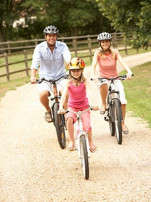 Exercise as a family to encourage children to lead a healthier and active lifestyle.