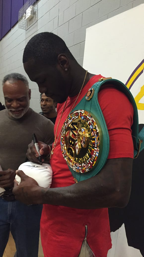 WBC Heavyweight Champion Deontay Wilder signs autographs at Columbus Middle School on Thursday.