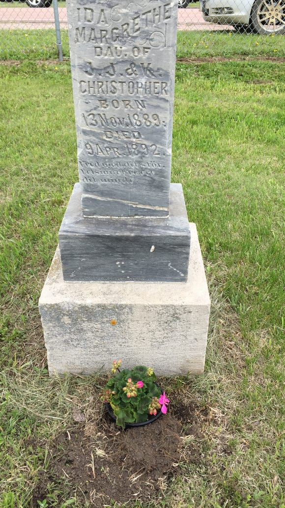 A geranium marks the final resting place of Ida Christopher.