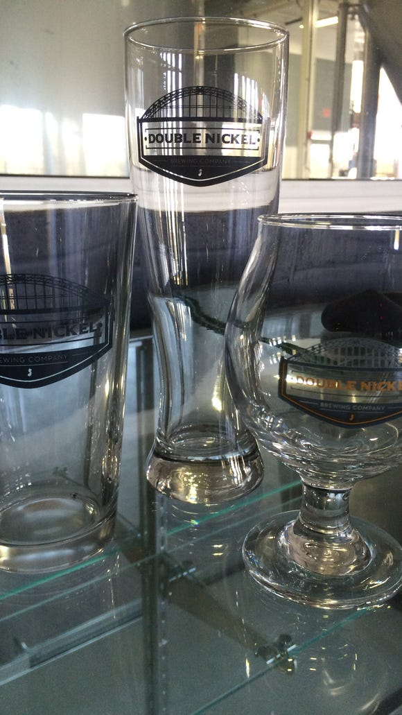 Glassware stands ready for Double Nickel brews. The brewery will eventually have a gift shop.
