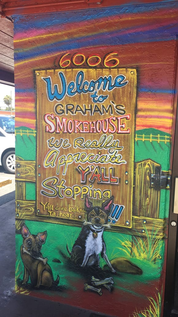 Two happy chihuahuas welcome guests to Graham's Smokehouse in Cape Canaveral.