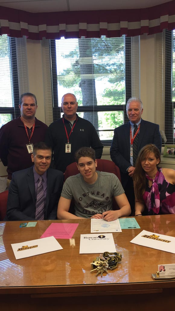 Fair Lawn senior MarcAnthony Rodriguez makes formal commitment to swim at Rowan University. Joining MarcAnthony (seated center) are his parents Domingo and Johanny. Standing, from left, Fair Lawn Athletic Director Cory Robinson, Cutters swim coach Rick Kelly and Fair Lawn Principal Jim Marcella.