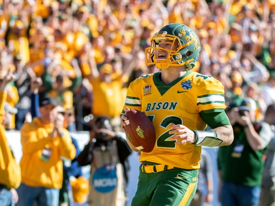 North Dakota State quarterback Easton Stick (12) smiles as he scores the final touchdown of the game against Eastern Washington during the second half of the 2019 FCS championship game.