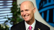 Florida Gov. Rick Scott, an early Trump backer, dismisses concerns about the new president's low ratings.