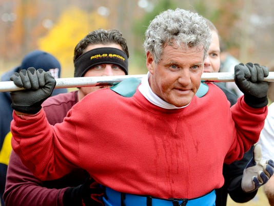 """Steve Jones, 63, front, of Camp Hill, is spotted by his son Steve Jones Jr., left, as he makes his 37th Annual """"Climb for the Kingdom,"""" on the Minuteman Hill at Roundtop Mountain Resort in Lewisberry, Pa. on Saturday, Nov. 7, 2015. Dawn J. Sagert - dsagert@yorkdispatch.com"""