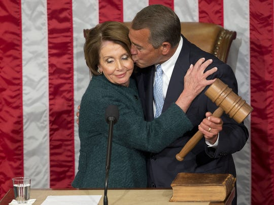 House Speaker John Boehner of West Chester kisses House Minority Leader Nancy Pelosi after he was elected to a third term in 2015.