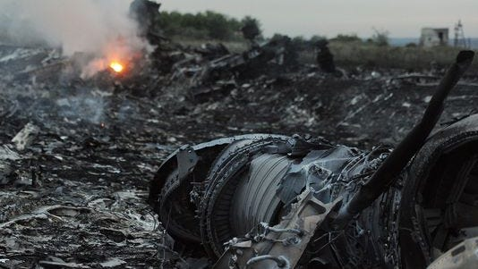 Wreckage of the Malaysian airliner carrying 295 people from Amsterdam to Kuala Lumpur after it crashed, near the town of Shaktarsk, in rebel-held east Ukraine.