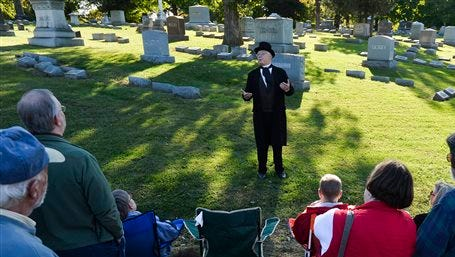 Prairie Folklore Theatre actors portray famous Peorians during the Historic Springdale Cemetery Tour in Peoria, Ill. The cemetery in central Illinois is embarking on a unique marketing campaign that includes a 5K race and actors dressing as people buried there, in an effort to encourage more people to buy lots. Ten events will be hosted this month in an effort to diversify the appeal of the sprawling East Bluff property.