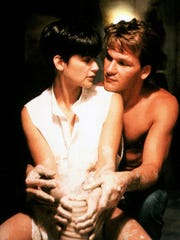 """Demi Moore and Patrick Swayze get up close and personal in """"Ghost."""""""