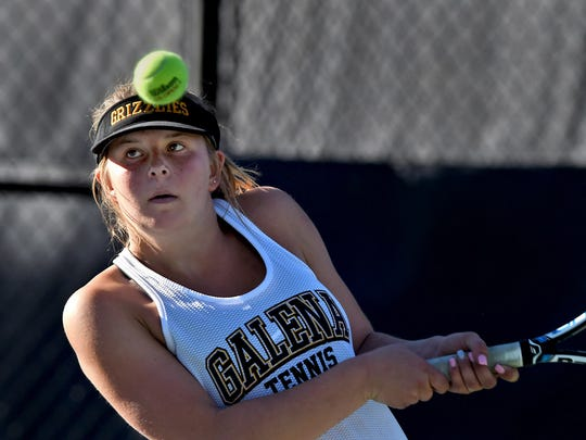Galena's Kaija Hess hits a backhand return again Reno's Erica Schwab during Friday's match in in the Northern 4A Regional team tournament at the Caughlin Athletic Club on Oct. 6, 2017.