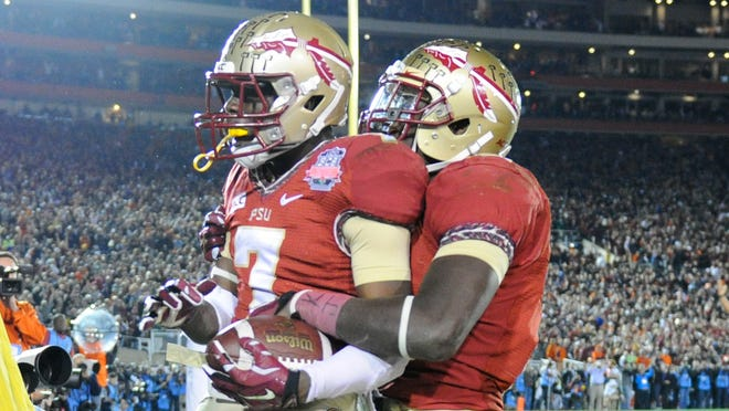 Florida State receiver Levonte Whitfield (7) celebrates with running back Karlos Williams (9) after scoring on a 100-yard kickoff return against Auburn in the fourth quarter of the 2014 BCS National Championship at the Rose Bowl.