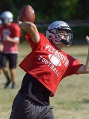 Launching a spiral during practice is Plymouth quarterback
