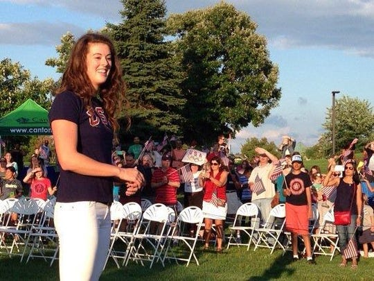 U.S. Olympic gold-medal winner Allison Schmitt revels in the hometown welcome during a 2016 rally at Heritage Park Amphitheater in Canton Township.