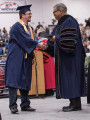 Jeffress with a graduating student.