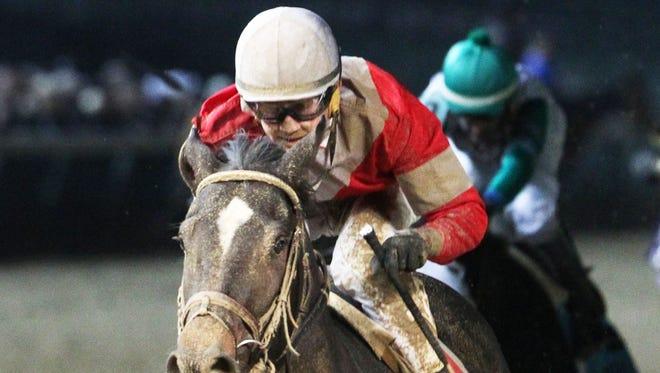McCraken, with jockey Brian Hernandez Jr. aboard, runs to a win in the Grade II Kentucky Jockey Club Stakes at Churchill Downs.