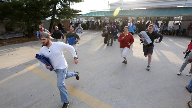 Fans storm the infield in hopes of getting a good seat for the 141st running of the Kentucky Derby.