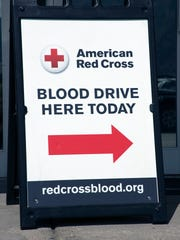A sign points to a blood drive at an American Red Cross