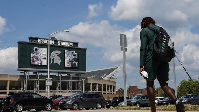 A Michigan State University Football player walks back to his car at Spartan Stadium following practice on the campus in East Lansing on Monday, August 10, 2020. The Big Ten and Pac-12 have cancelled their 2020 college football seasons.