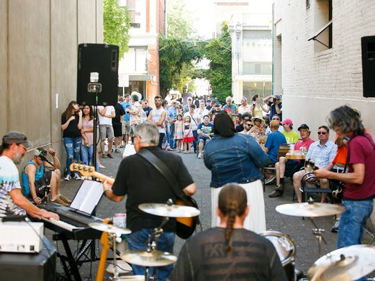 A crowd gathers to listen to Ayanarr perform outside of Taproot at Make Music Day in Downtown Salem on Wednesday, June 21, 2017.