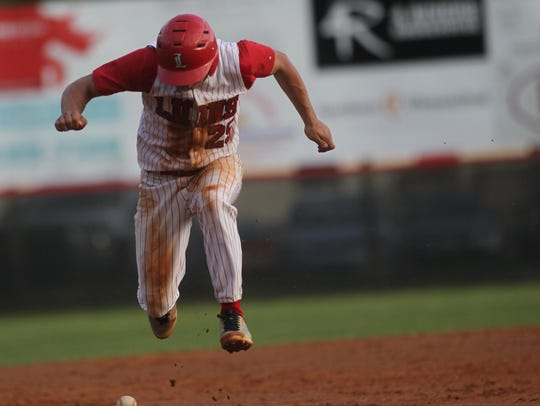 Leon's Tyler Borges jumps over a grounder hit at him
